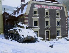 """A German Sherman - 5th Fallschirmjäger Division captured six M4 tanks during the fighting near Wiltz, Luxembourg on 19th December 1944.  Here a destroyed re-purposed German M4 sits in front of """"Hotel des Ardennes"""", Esch-sur-Sure, Luxembourg, January 1945.   The Wehrmacht captured its first Shermans in Tunisia and shipped them back to Germany for the Army Weapons Office to examine.  (Cleaned up & Colourised by Paul Reynolds) https://www.facebook.com/PhotoColourisation"""