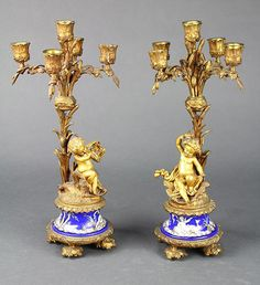 Pair of Louis XV style gilt bronze candelabra, each having five lights, above stylized arms decorated with cattails, continuing to t. Lantern Candle Holders, Candle Lanterns, Candle Lighting, Porcelain Vase, Fine Porcelain, Floor Lanterns, Porcelain Dolls For Sale, Oil Candles, Vintage Chandelier