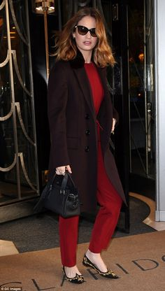 Get actress Lily James' red Tommy Hilfiger jumpsuit, Burberry coat, and Louboutin smoking flats look for less | The Luxe Lookbook