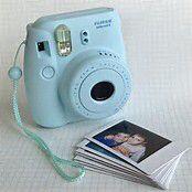 Light blue Polaroid camera