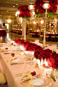 red and gold table settings and decorations I love the red flowers against the white table cloths.
