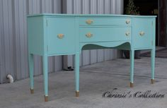 "Sheraton style buffet painted in Blue Waltz with gold tipped feet and hardware. High end, well built piece. Measures 68""x23"" and 38.5""t. $495."
