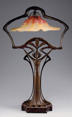 Stunning Art Nouveau French figural table light, H. Cased glass, clear, milky white, red and orange powder fusions. Antique Lamps, Antique Lighting, Design Art Nouveau, Lampe Art Deco, Lampe Retro, Jugendstil Design, Art Nouveau Furniture, Art Deco Lighting, Table Lighting