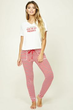 """A knit PJ set featuring a tee with the graphic """"First Things First, Give Me My Presents"""" on the chest, a V-neckline, and short sleeves, as well as a pair of PJ pants with allover stripes, an elasticized drawstring waist, and front patch pockets."""