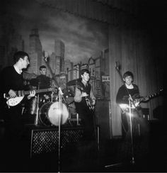 """1962. The Beatles performing at the Star Club during their second tour in Hamburg, Germany. From left to right: John Lennon, Paul McCartney and George Harrison. The Beatles became the """"house"""" band of the club and had to play long and hard, from 8 pm to 4 am. They were paid $500 a week. The Star Club had a capacity up to 1000 and they always packed the club with their loud, brash, fast, rock music Germans loved. #Beatles #1962 #StarClub"""