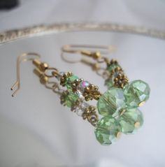 Beautiful green glass Crystal earrings ready to ship with a free gift box and handmade tag with crocheted heart.    Measuring from the gold ball on