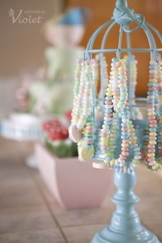 Candy necklaces on a jewelry holder.  Adorable for a little girls birthday party! And you can totally paint and decorate the jewelry holders to match the theme...I bet even all the boys would be okay with this jewelry as a favor : )