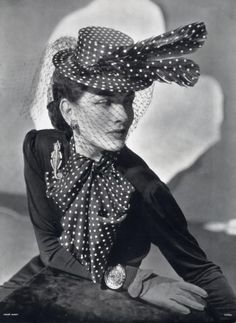 1940: Agnès millinery, jewellery by René Boivin (note the 'Chameleon' brooch). Photo: Andre Durst.