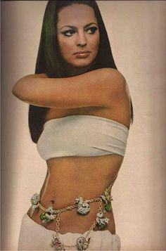 Ira von Furstenberg bares a golden waist draped in Tiffany sea dragons. Photography: Gianni Penati 1968