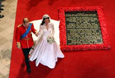 The Duke and Duchess of Cambridge walk past the Tomb of the Unknown Warrior inside Westminster Abbey as they leave after their wedding.