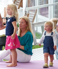 Autumn Phillips, Savannah Phillips (L) and Mia Tindall (R) attend day 1 of the Festival of British Eventing at Gatcombe Park on August 7, 2015 in Stroud, England.