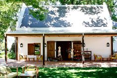 The plaaswinkel / farm shop at La Motte Wine Estate in Franschhoek. Pierre Cronje custom made the doors of the plaaswinkel as well as the shopfitting of the interior, Interior Design by Christiaan Barnard. Christiaan Barnard, Farm Shop, Reception Areas, South Africa, Exterior, Traditional, Interior Design, Country, Places