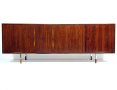 A rare and beautiful 1960s sideboard in Rio rosewood by Arne Vodder for Sibast.   It has perfectly-crafted tambour doors, steel legs and rosewood-tipped feet.   The maple interior features adjustable shelving, baize-lined drawers and a dry bar on the right hand side.   At 226cm in length it makes a powerful statement.   It is in excellent restored condition.