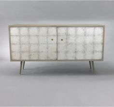 can't afford a $2040 media cabinet but i do love the silver leafing in sheets on this. MUST DO!