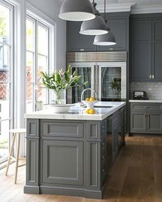 I like the idea of darker cabinets (maybe a blue gray), white trim, and lighter walls - like this but maybe more blue-ish