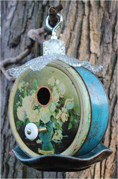 Blue BirdHouse Vintage Carr & Co. Biscuit Tin Recycled Bird House Canadian Repurpose Blue Mountain Pottery Bowl Antique Glassware Birdhouse by JunkWhisperers  All of our birdhouses are made from materials that are vintage, recycled or reclaimed objects. We love the adventure of finding pieces that fit together to create a wonderful birdhouse.  Each house is ready for your garden and ready for a bird family to move in, I would put it in a shady garden spot as it is made from metal.  Constr...