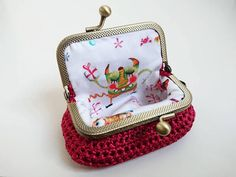 Box Shaped coin purse crochet from luxury silky ribbon yarn and lined with adorable happy monster 100% cotton fabric. Sewed with great care on to bronze tone kiss lock frame, therefore interior stitches are unseen. Coin purse unique shape designed by me, coins are very easy accessible.