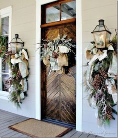 What a beautiful door and great Christmas decor! Candle Impressions large Outdoor Flameless Pillars would be a great addition on either side of the door.