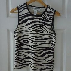 Classic Sleeveless Top Pretty zebra print can be dressed up with a blazer or just casual; fits more like a medium Tops