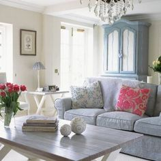 lovely light blue and grey living room with pink accents