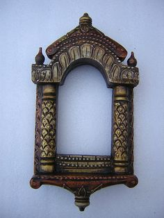 Hand Crafted, Hand Embossed mirror frame painted in copper and antique gold.