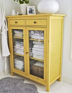 bathroom hutch. This would look so much better than my rubbermade three drawer thing!