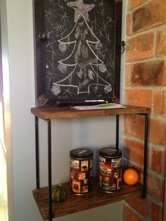Industrial  wooden  shelf with a noticeboard in our kitchen made by HDfurniture.