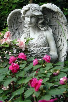 Angel Statue in my Mother's Garden by Sarah Andrew, via Flickr