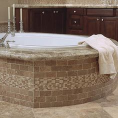 Mexican Noce Tumbled 2x4 Brick with ST-115 Listelle on Tub and Stormy Travertine on Floor