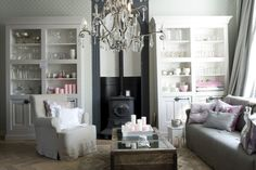 I love how the bookcases flank the pot belly stove instead of a fireplace Living Room With Fireplace, Living Rooms, Potbelly Stove, Bookshelves, Bookcase, Rustic Mantle, China Storage, Grey Interiors, Stove Fireplace