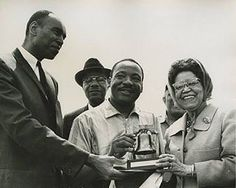 Today we honor the life and legacy of Dr. Martin Luther King, Jr. Here he is being presented a replica Liberty Bell by Sadie Tanner Mossell Alexander, one of the first African-American women to receive a PhD in the US, and Terry C. Chisholm, the executive director of Philadelphia's Commission on Human Relations, at the civil rights march from Selma to Montgomery, AL. #MLK