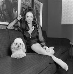 Writer and actress, Jackie Collins, at home with her pet poodle. February 3, 1968