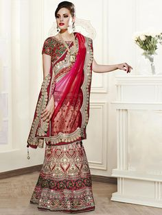 Captivating red and off white net festival wear designer lehenga choli. Having fabric net, velvet and silk. The appealing thread work, embroidery work, resham embroidery work, zari work, lace border work, zari border and stone work a significant element of this attire. Comes with matching choli and dupatta. #mydesiwear #LehengaCholi #WeddingLehengaCholis #BridalLehengaCholi #BollywoodLehengaCholi #Net #WeddingCollections #WeddingLehengaDesigns #BridalGowns #valentinesday…