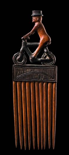 Africa | Comb from the Chokwe people of DR Congo | Wood, light and dark brown patina