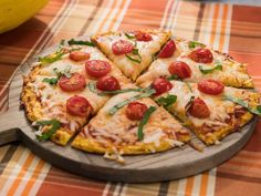 Get Spaghetti Squash Pizza Crust Recipe from Food Network - Squeeze out squash in cloth after cooked - can wrap and freeze crust