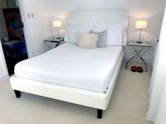 """Helen sent in this photo of her standard double size Canterbury Bed, finished in our white upholstery.  We recently caught up with Helen, this is what she said about her experience with us - """"Very well made bed, excellent quality. But wrong bed legs sent and fabric stains easily, had to replace a bed part."""""""