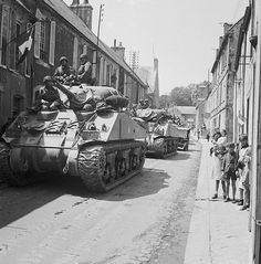 The Battle for Normandy: Sherman tanks of British 30th Corps passing through Bayeux, liberated by the British 50th Infantry. 1944