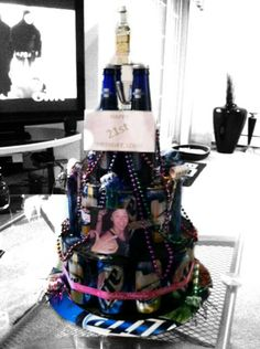 The Best Beer Cake Ever. :) Use vinyls to seperate layers, use cans and bottles, wrap with birthday ribbon, top with a shooter and shotglass..decorate with beads, plastic shot glasses, ballons, pictures, words..whatever!