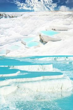 """Pamukkale, meaning """"cotton castle"""" in Turkish is a natural site in southwestern Turkey that has existed for thousands of years. 20 UNREAL Travel Destinations you have to see!! Click through to read the full post!"""