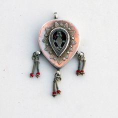 The piece is completely hand constructed, with hand cut embellishments soldered on. It is hollow inside, but closed in the back. It does sho...