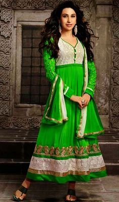 Blend up your elegance and smart looks like Karisma Kapoor in this green and cream chiffon long Anarkali churidar suit. The ethnic lace work with clothing adds a sign of splendor statement for your look. #BollywoodKarismaKapoorAnarkaliSuit
