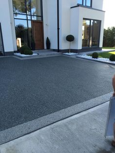 Slate Grey is a grey resin bound gravel colour for resin drives, paths & patios. Resin Driveway, Resin Patio, Asphalt Driveway, Driveway Paving, Driveway Landscaping, Pebble Driveway, Blacktop Driveway, Garden Paving, Stained Concrete Driveway