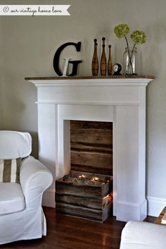 Faux fireplace, I like the reclaimed barn wood look as the insert