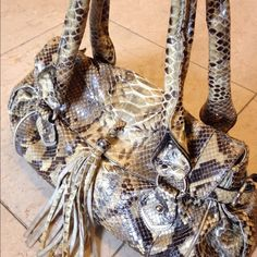 """Real snake skin made in Italy hand bag Made in Italy genuine snake skin in gold grey brown. Silver hardware.  2 flaps inside with 2 zipper pockets. 1 phone case pouch. Magnetic snap closure.  In mint condition. No stains or rips. 14""""x8"""". 4"""" depth. Ghibli Bags"""