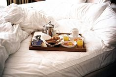 I love beds, bedding, breakfast in bed, and the morning light...on a bed. Love.