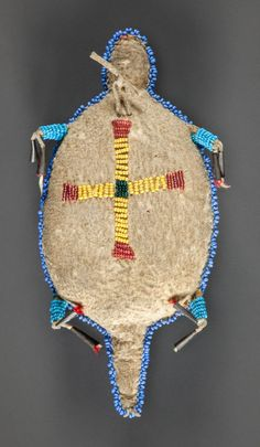 A SIOUX BEADED HIDE FETISH. c. 1890