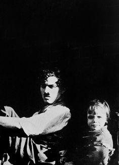 """Charlie Chaplin & Jackie Coogan, set of """"The Kid"""", taking a break."""
