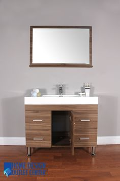 This unique modern design bathroom vanity will give your bathroom a trendy and totally up-to-date appearance.  Highest quality MDF/Wood veneer cabinet.  Light walnut color.  White acrylic sink.  Pop-up drain assembly.  Self closing door & drawers.  Matching mirror.  Side cabinet available.  Vanity has opening for plumbing.  Single hole faucet openings.  Minimal assembly required (finished cabinet).