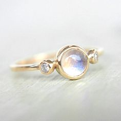 Hey, I found this really awesome Etsy listing at https://www.etsy.com/il-en/listing/214846141/rainbow-moonstone-and-diamond-ring-14k
