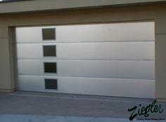 Without the windows. Metal & Glass Garage Doors modern-garage-doors-and-openers